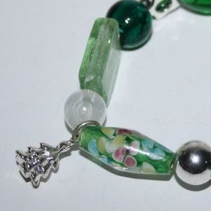 Beautiful green glass and tree charm bracelet